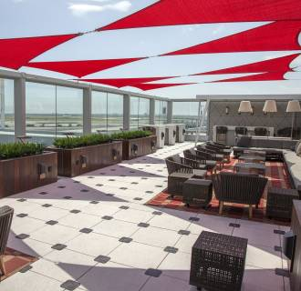 Image: Delta Air Lines lounge with outdoor deck in Terminal 4 at New York's JFK airport.