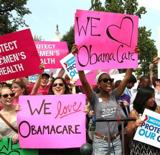 Image: Obamacare supporters react to the  U.S. Supreme Court decision to uphold President Obama's health care law