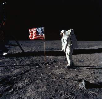 Image: Astronaut Edwin E. Aldrin stands beside the United States flag
