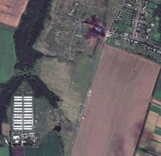 Image: DigitalGlobe's QuickBird satellite captured this image of the Malaysia Airlines Flight 17 crash site in the settlement of Grabovo in eastern Ukraine, on Sunday.