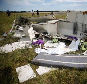 Image: Parts of the wreckage are seen at a crash site of the Malaysia Airlines Flight MH17 near the village of Hrabove