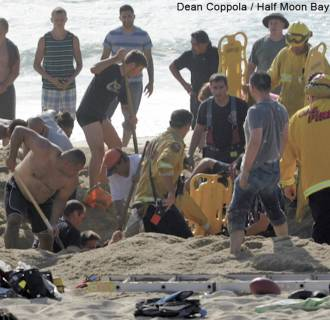 Image: Emergency crews and volunteers work to rescue a man at Francis State Beach on Monday