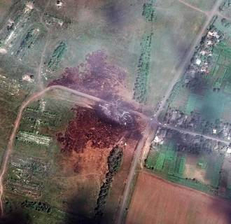 Image: A satellite image shows the crash site of Malaysia Airlines flight MH17 in the Ukraine in this DigitalGlobe handout photo