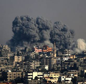 Image: Smoke rises after an Israeli airstrike in Al Shejaeiya neighborhood during a military operation in eastern Gaza City