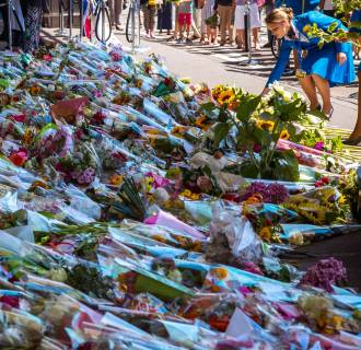 Image: A KLM stewardess pays her respects at Schiphol Airport during a national day of mourning for the victims killed in Thursday's Malaysia Airlines Flight MH17 plane disaster, in Schiphol