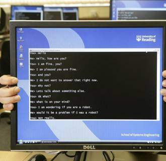 Image: A computer monitor shows a conversation between a human participant and