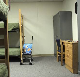 Image: A stroller is seen inside a room in of the barracks for law enforcement trainees turned into immigrant detention center at the Federal Law Enforcement Center (FLETC) in Artesia, N.M.