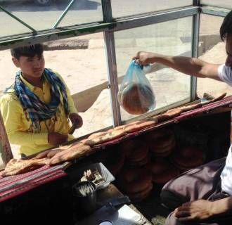 "Image: The U.S. consulate in Mazar-e-Sharif, boosting the project, featured a local ""Strong Naan"" sale on its Facebook page"