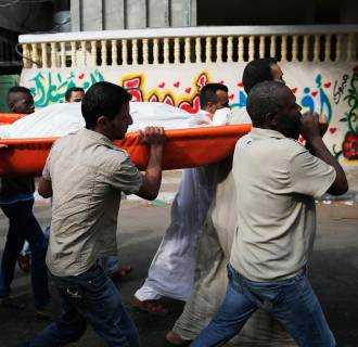 Image: Palestinians carry a body during a funeral in Jabaliya in the northern Gaza Strip,