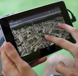 Image: An attendee uses Google Map on a Google Nexus 7 tablet during Google I/O 2012 Conference at Moscone Center in San Francisco