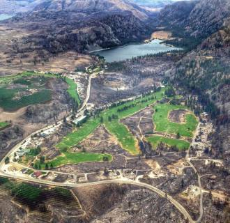 Image: An aerial cellphone photo shows a largely burned landscape near Alta Lake, Pateros, Wash.