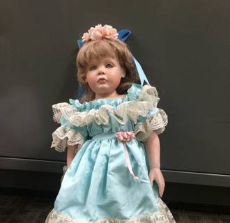 Image: Somebody is leaving porcelain dolls on the doorsteps of Southern California homes  — dolls, the families say, that each bear a striking and creepy resemblance to their young daughters