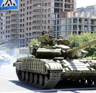 Image: Pro-Russian militants drive a tank in the eastern Ukrainian city of Donetsk