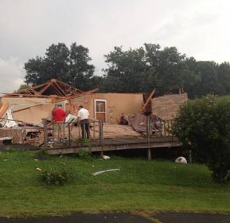 Image: A family looks at their destroyed home after a tornado hit Kingsport, Tenn., on Sunday evening.