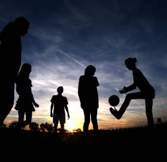 Image: Youth soccer players kick a ball around outside of University of Phoenix Stadium.