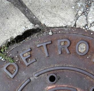 Detroit's retirees and active employees have approved its proposed debt-cutting plan.