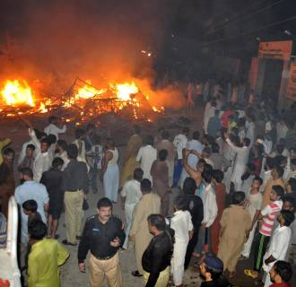 Image: Mob attacked religous minority following blasphemy accusations
