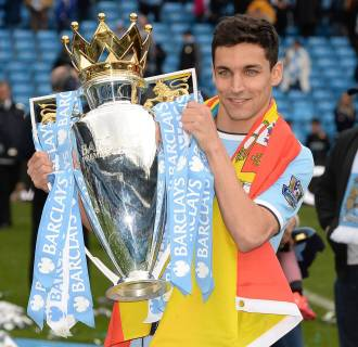 Image: Manchester City's Navas poses with the trophy after winning the league following their English Premier League match against West Ham United in Manchester