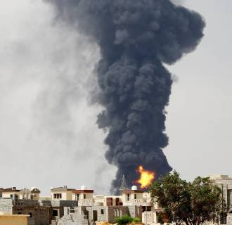 Image: Smoke from a burning oil depot near Tripoli airport