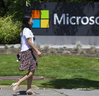 Microsoft says Chinese officials made sudden visits to its offices in China. The company did not say why.