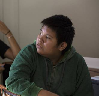 Image: Columbia University graduate Fantasia Painter, 23, left, from Phoenix  urges Taylor Thomas , 12, in a discussion about Native American stereotypes with a group of high school and younger students on the Tohajiilee reservation .