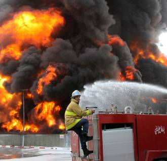Image: A Palestinian firefighter works during efforts to extinguish a fire at Gaza's main power plant, which witnesses said was hit in Israeli shelling, in the central Gaza Strip