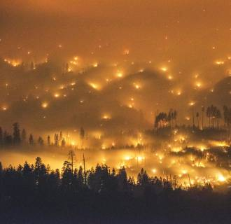 Image: A long exposure image shows the El Portal Fire burning near Yosemite National Park