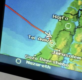 Image: A navigation screen on the plane of US Secretary of State John Kerry shows its approach to Tel Aviv