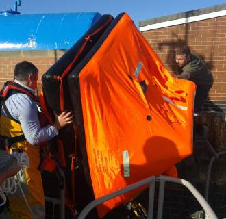 Liferaft being brought ashore at Hartlepool Fish Quay.