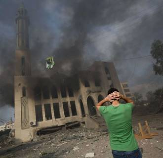 Image: A Palestinian man reacts in front of a destroyed mosque after it was hit by an Israeli airstrike