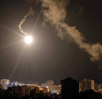 Image: Israeli forces' flares light up the night sky of Gaza City