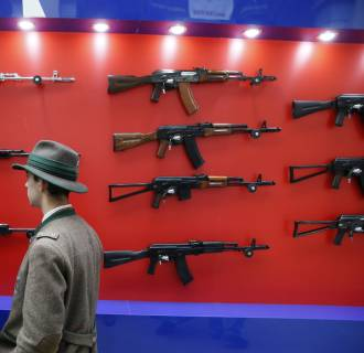 Image: Visitors view Kalashnikov automatic rifles during the Arms and Hunting Exhibition in Moscow, Russia, on Oct. 10, 2013