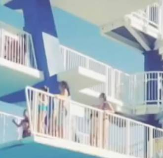 Image: A woman was about to jump off a platform at an Idaho water park and got spooked when a man jumped at the same time