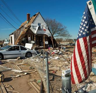 Image: A house is seen with its entire first floor washed away, as well as the entire surrounding area demolished when Hurricane Sandy hit Staten Island