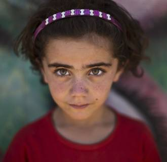 Image: Syrian refugee Samah, 5, poses at Zaatari refugee camp, near the Syrian border, in Mafraq, Jordan on July 29