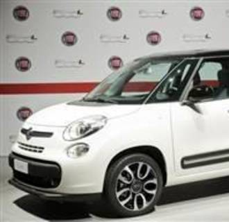 The new Fiat 500L car is seen during its official presentation in downtown Turin