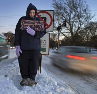Image: Victoria Morris, 28, panhandles in Portland, Maine, where the temperature at dusk was 7 degrees Fahrenheit