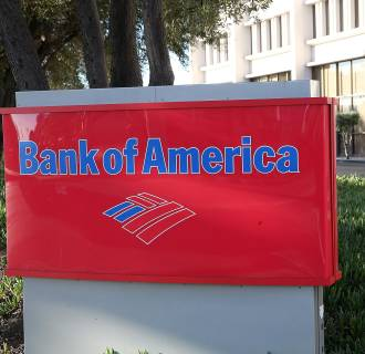 Image:  A sign is posted in front of a Bank of American branch office