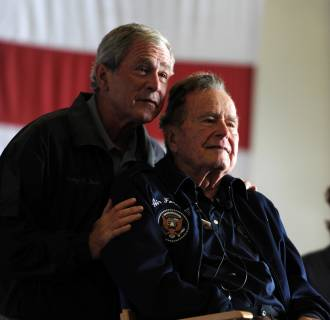Image: Former Presidents George W. Bush, left, and his father, George H.W. Bush