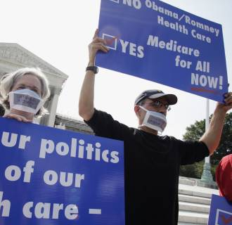 Image: Doctors protest against individual mandate in President Obama's health care reform in front of U.S. Supreme Court in Washington
