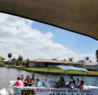 Image: Boat Tours Give Buyers Close-Up View Of Foreclosed Homes