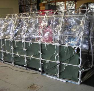Image: This special containment unit is designed to transport patients with highly infectious diseases. A unit like this may be used to transport patients with the Ebola virus.