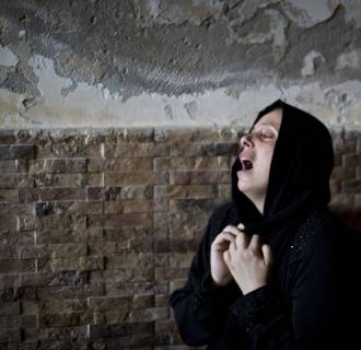 Image: The sister of Mohammed al-Daeri, 25, mourns during his funeral in Gaza City