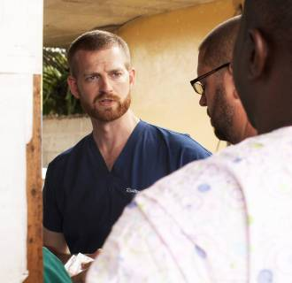 Image: Dr. Kent Brantly speaking with colleagues at the case management center on the campus of ELWA Hospital in Monrovia
