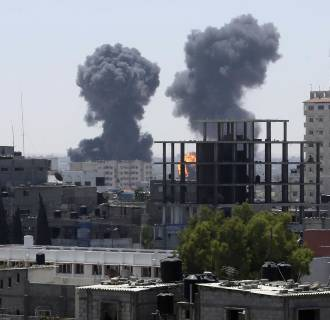 Image: Smoke and flames are seen following what witnesses said were Israeli air strikes in Rafah in the southern Gaza Strip