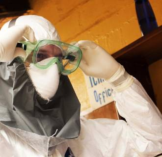 Image: Handout photo of Dr. Kent Brantly wearing protective gear at the case management center on the campus of ELWA Hospital in Monrovia