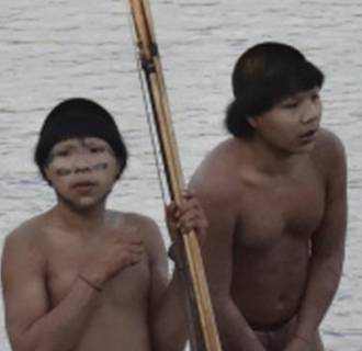 Image: Two members of a previously uncontacted tribe stand on the bank of the Envira river