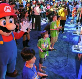 Image:Children play video games at Nintendo's booth during E3 on June 11, 2014, in Los Angeles.