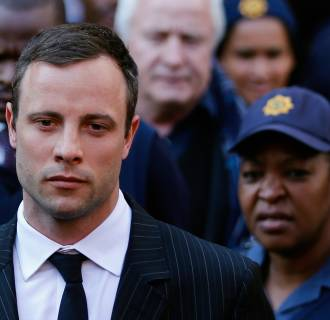 Image: Oscar Pistorius leaves after the closing arguments in his murder trial at the high court in Pretoria