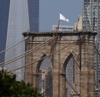 Image: White flags fly on the Brooklyn Bridge
